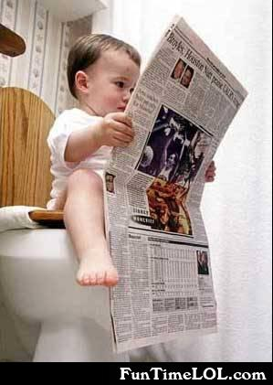 baby on the toilet reading newspaper