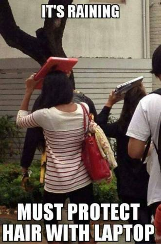 it's raining - must protect hair with laptop